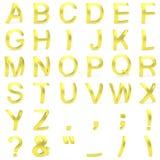从弯曲的3D大写字母的金黄字体 库存照片