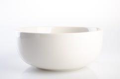弯脚的 在背景的陶瓷碗 在背景的陶瓷碗 免版税库存照片