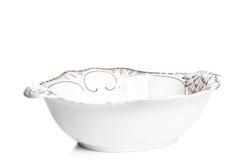 弯脚的 在背景的陶瓷碗 在背景的陶瓷碗 库存照片
