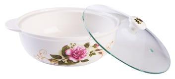 弯脚的 烹调在白色的陶瓷碗 库存图片