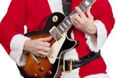 弹一把电吉他的父亲圣诞节 库存图片