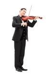 弹一把音响小提琴的典雅的音乐家 库存图片