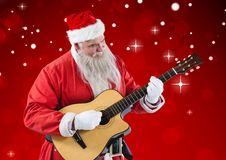 弹吉他的圣诞老人 库存图片