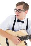 弹吉他的讨厌的行家 免版税库存照片