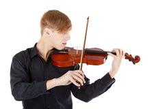 弹小提琴的男孩图象 免版税库存照片