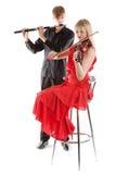 弹小提琴的长笛音乐家 免版税图库摄影