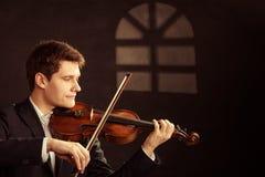 弹小提琴的人小提琴手。古典音乐艺术 库存图片