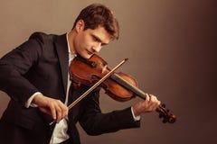 弹小提琴的人小提琴手。古典音乐艺术 免版税库存图片