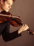 弹小提琴的人小提琴手 古典音乐艺术 免版税库存图片