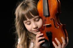 弹小提琴的小提琴手 免版税库存照片