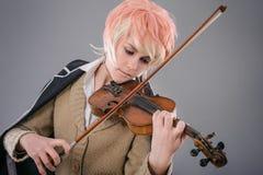弹小提琴的年轻执行者妇女 免版税库存图片