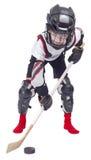 弹药的年轻曲棍球运动员 免版税库存图片