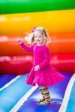 弹起的小女孩跳跃和 图库摄影