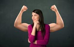 强和肌肉的胳膊概念 库存照片
