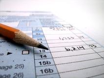 归档的税的税文件在美国1040和铅笔 免版税图库摄影