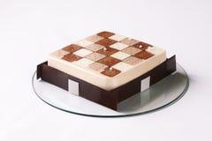 当代三巧克力沫丝淋蛋糕 免版税库存照片
