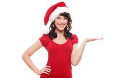 当前圣诞老人的兴奋女孩 库存图片