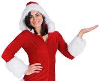 当前在圣诞老人成套装备的俏丽的女孩 库存照片