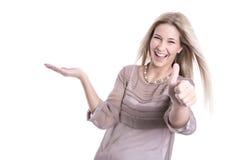 当前微笑的妇女和赞许-被隔绝在白色后面 免版税库存照片