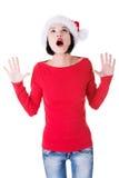 当前您的产品的圣诞老人女孩 库存照片