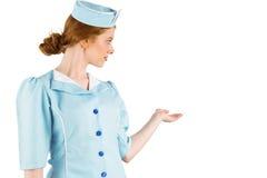当前用手的俏丽的空中小姐 免版税图库摄影