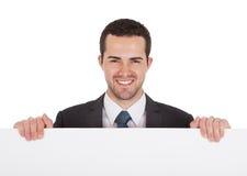 当前空的董事会的成功的生意人 免版税库存图片