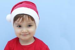 当圣诞老人微笑打扮的小孩 免版税库存照片