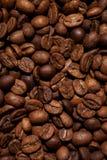 当背景是豆装使用的咖啡纹理于罐中 免版税库存照片