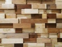 当背景的墙壁纹理被堆积的木块 免版税库存照片