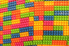 当背景纹理使用的难题的五颜六色的塑料玩具大厦砖块样式 图库摄影