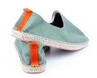 当代绿色帆布鞋 库存照片