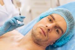 整形外科医生的人 免版税库存图片