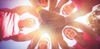 形成在新兵训练所的小组妇女手堆 免版税库存照片