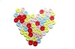 形成心脏形状的按钮 免版税库存照片
