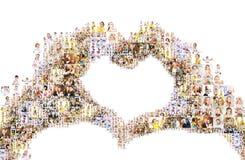 形成心脏,人拼贴画的手  图库摄影