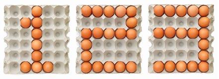 形成文本123的农厂鸡蛋 免版税图库摄影