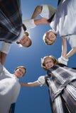 形成杂乱的一团的学校朋友 库存照片