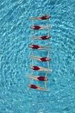 形成梯子的同步的游泳者 库存图片