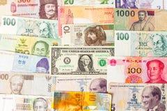形成背景的各种各样的货币钞票 库存照片