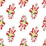 水彩手拉的圣诞节逗人喜爱的样式 与棒棒糖、弓、金黄星和霍莉叶子的无缝的背景 免版税库存照片
