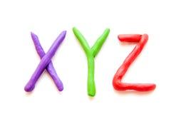彩色塑泥在XYZ上写字 库存图片