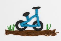 彩色塑泥自行车 免版税库存图片
