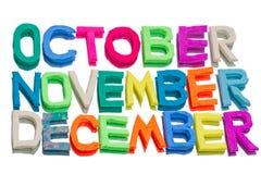 从彩色塑泥(10月、11月, 12月)的词 免版税库存照片
