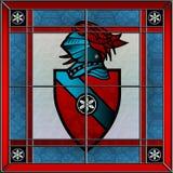 彩色玻璃徽章方形的窗口 免版税库存照片