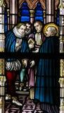 彩色玻璃-圣法兰西斯泽维尔和马蒂姆阿方索德索萨 免版税图库摄影