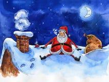 水彩蓝色例证 快活的圣诞节 屋顶的圣诞老人有袋子的礼物 图库摄影