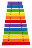 彩虹上色了木玩具木琴反对白色背景 库存照片