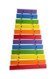 彩虹在白色隔绝的玩具木琴 免版税库存照片