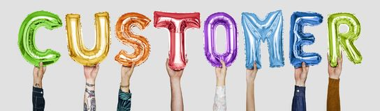彩虹形成词顾客的字母表气球 库存照片