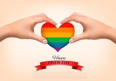 彩虹心形在手上 同性恋自豪日概念 库存照片